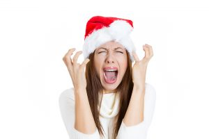 Stressed overwhelmed christmas young woman